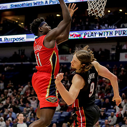 Dec 16, 2018; New Orleans, LA, USA; New Orleans Pelicans guard Jrue Holiday (11) misses a shot as Miami Heat forward Kelly Olynyk (9) defends during the second half at the Smoothie King Center. Mandatory Credit: Derick E. Hingle-USA TODAY Sports