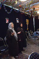 Tehran, Iran. October 1, 2007- Two women pray in the early morning at the Yousefabad Synagogue during Sukkot, the festival of rejoicing.