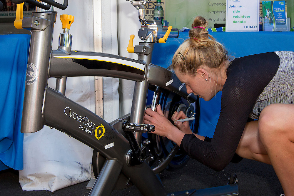 August 16, 2014, New Haven, CT:<br /> Alison Riske signs a Yale New Haven Health Spin Bike on day four of the 2014 Connecticut Open at the Yale University Tennis Center in New Haven, Connecticut Monday, August 18, 2014.<br /> (Photo by Billie Weiss/Connecticut Open)