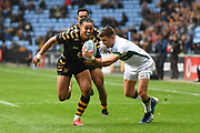 Wasps winger Marcus Watson (15) breaks the tackle of London Irish wing Ollie Hassell-Collins (11) during the Gallagher Premiership Rugby match between Wasps and London Irish at the Ricoh Arena, Coventry, England on 20 October 2019.