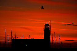 © Licensed to London News Pictures. 29/09/2018. Scarborough UK. The sky turns red at dawn this morning behind Scarborough light house in Yorkshire. Photo credit: Andrew McCaren/LNP