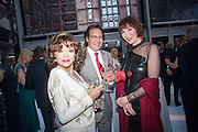 JOAN COLLINS; PERCY GIBSON; CAROL VICTOR, CARTIER CHELSEA FLOWER SHOW DINNER Dinner hosted by Cartier in celebration of the Chelsea Flower Show was held at Battersea Power Station. 22 May 2012
