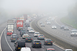 &copy; Licensed to London News Pictures. 18/04/2019.<br /> Swanley, UK. Easter bank holiday weekend getaway traffic starts early with heavy fog and heavy traffic making the M25 in Kent, Clock-wise near Junction three for Swanley look more like a car park then a motorway this morning. Photo credit: Grant Falvey/LNP