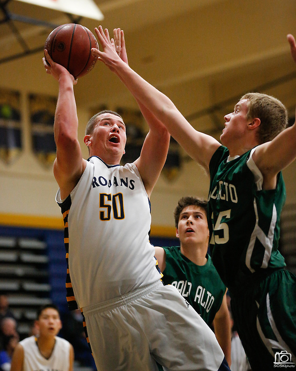 Milpitas center Jason Scrempos (50) shoots the ball over Palo Alto's Matt Fogarty (25) at Milpitas High School in Milpitas, California, on January 31, 2014.  Milpitas beat Palo Alto 51-39. (Stan Olszewski/SOSKIphoto)