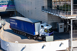 © Licensed to London News Pictures. 26/03/2020. London, UK. Trucks arrive at the ExCeL London exhibition centre. The huge exhibition centre in London is to be used as a field hospital during the COVID-19 coronavirus pandemic. Photo credit: Peter Manning/LNP