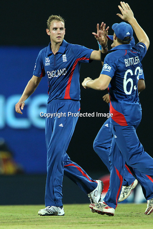 Stuart Broad (Captain) of England  celebrates the wicket of Jeewan Mendis with Jos Buttler of England  during the ICC World Twenty20 Super Eights match between England and Sri Lanka held at the  Pallekele Stadium in Kandy, Sri Lanka on the 1st October 2012<br /> <br /> Photo by Ron Gaunt/SPORTZPICS