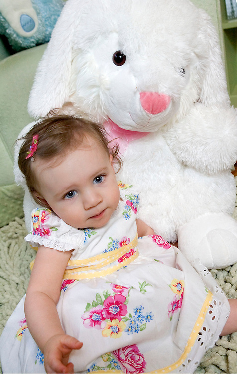 WATERBURY, CT- 18 MARCH 2008- 031808JT02-.Grace Rogers, 14-months-old, poses with a toy Easter bunny at her Waterbury home on Tuesday..Josalee Thrift / Republican-American