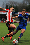 Ryan Jennings and Harry Morgan during the FA Trophy match between Cheltenham Town and Chelmsford City at Whaddon Road, Cheltenham, England on 12 December 2015. Photo by Antony Thompson.