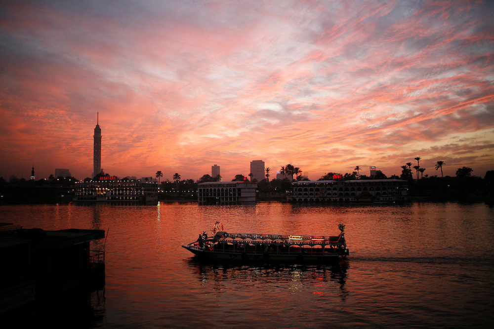 A Faluka boat on the Nile River in Cairo. The Cairo Tower is seen in the background.