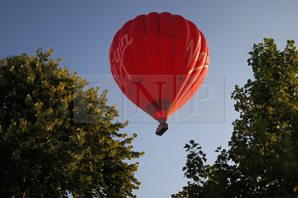 © Licensed to London News Pictures. 31/07/2014. Basingstoke, Hampshire, UK. A group of people have an early start to take a balloon flight from Basingstoke in Hampshire this morning, 31st July 2014. The warm, sunny weather is continuing over the UK. Photo credit : Rob Arnold/LNP