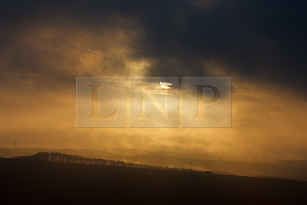 © Licensed to London News Pictures. 25/01/2014. Hampshire, UK. Low cloud and mist across the North Wessex Downs in Hampshire today (25/01/2014). Strong winds and rain are forecast for the weekend. Photo credit : Rob Arnold/LNP