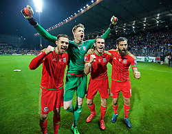 ZENICA, BOSNIA & HERZEGOVINA - Saturday, October 10, 2015: Wales' Aaron Ramsey, goalkeeper Wayne Hennessey, Gareth Bale and Joe Ledley celebrate qualifying for the Euro 2016 finals despite a 2-0 defeat to Bosnia and Herzegovina during the UEFA Euro 2016 qualifying match at Stadion Bilino Polje. (Pic by David Rawcliffe/Propaganda)