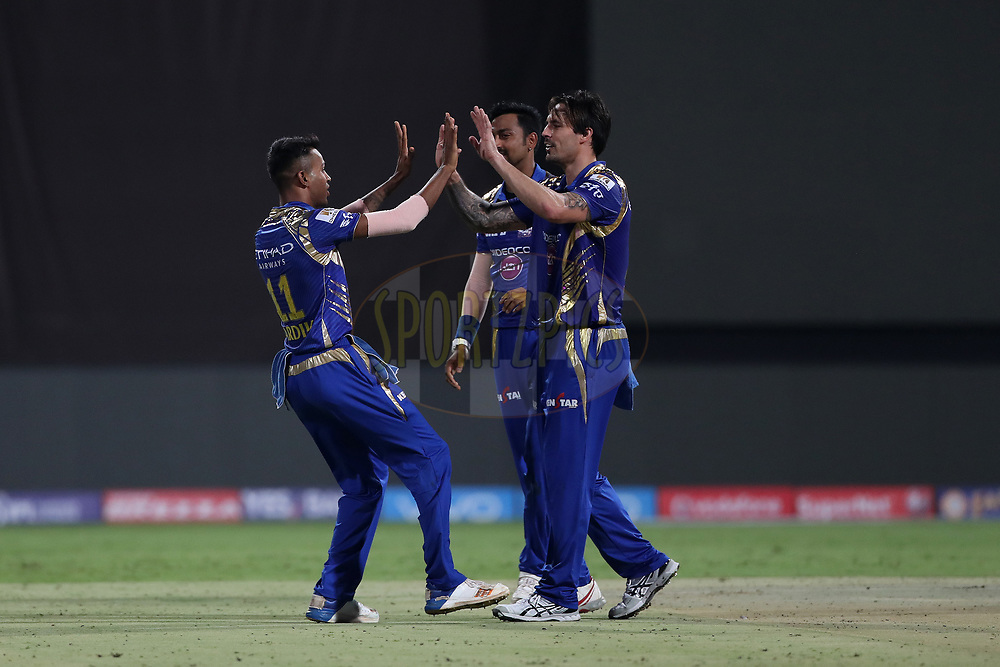 Hardik Pandya of the Mumbai Indians celebrates the wicket of Nathan Coulter-Nile of the Kolkata Knight Riders with Mitchell Johnson of the Mumbai Indians during the 2nd qualifier match of the Vivo 2017 Indian Premier League between the Mumbai Indians and the Kolkata Knight Riders held at the M.Chinnaswamy Stadium in Bangalore, India on the 19th May 2017<br /> <br /> Photo by Ron Gaunt - Sportzpics - IPL