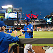 Manager Joe Maddon, Chicago Cubs, congratulates Kris Bryant on what proved to be the winning run in the Cubs 1-0 victory during the New York Mets Vs Chicago Cubs MLB regular season baseball game at Citi Field, Queens, New York. USA. 14th April 2015. Photo Tim Clayton