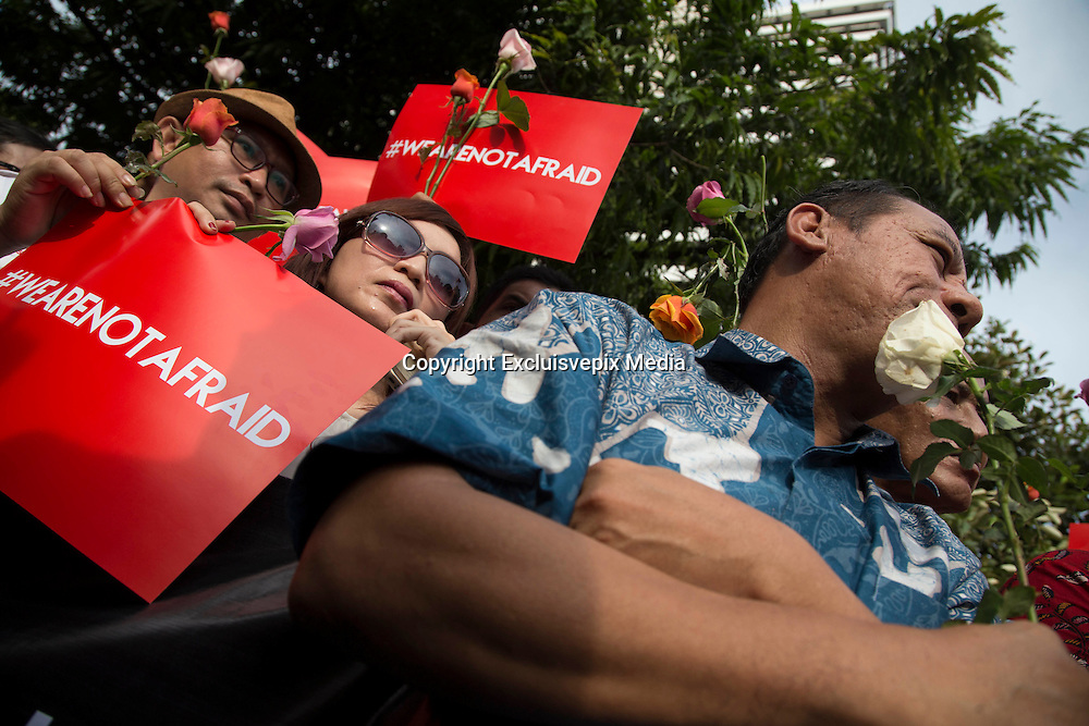 """Jakarta, Indonesia, 15 January 2016 : Hundreds of people gathered in front of Starbuck Coffee bombing location to give solidarity to the victim of the bombing. They yell """"we are not affraid"""" to the act terrorist that killed seven people. <br /> ©Excluisvepix Media"""