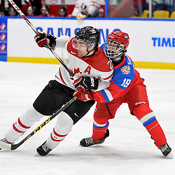 WHITBY, - Dec 14, 2015 -  Game #4 - Russia vs. Canada East at the 2015 World Junior A Challenge at the Iroquois Park Recreation Complex, ON. Maxime St. Pierre #25 of Team Canada East battles for position with Kirill Slepets #19 of Team Russia during the second period.<br /> (Photo: Shawn Muir / OJHL Images)
