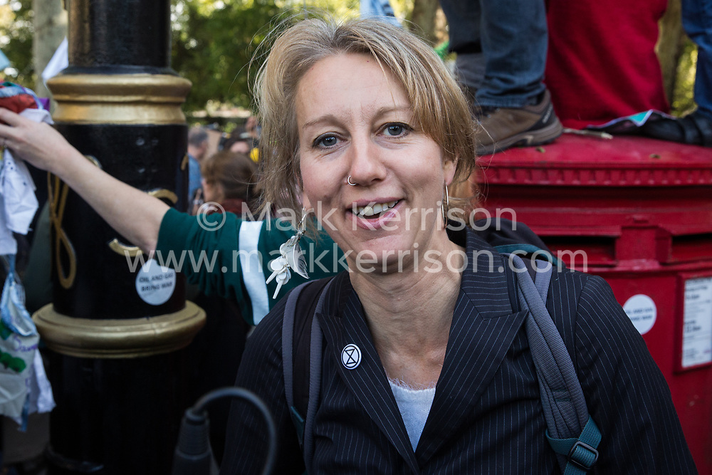 London, UK. 8 October, 2019. Dr Gail Bradbrook, co-founder of Extinction Rebellion, joins fellow climate activists blocking Millbank on the second day of International Rebellion protests to demand a government declaration of a climate and ecological emergency, a commitment to halting biodiversity loss and net zero carbon emissions by 2025 and for the government to create and be led by the decisions of a Citizens' Assembly on climate and ecological justice.