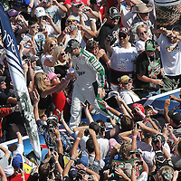 Sprint Cup Series driver Dale Earnhardt Jr. (88) greets fans during introductions at Daytona International Speedway on February 20, 2011 in Daytona Beach, Florida. (AP Photo/Alex Menendez)