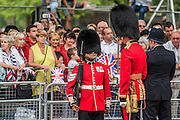 The shortest Guardsman is inspected by his officer - Queens 90th birthday was celebrated by the traditional Trooping the Colour as well as a flotilla on the river Thames.