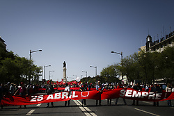 April 25, 2018 - Lisbon, Portugal - Demonstrators march through downtown Lisbon on April 25, 2018 during a rally to celebrate the 44th anniversary of the Portuguese revolution. (Credit Image: © Carlos Costa/NurPhoto via ZUMA Press)