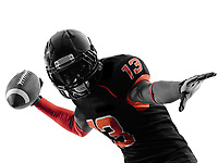 one american football player quarterback passing portrait in silhouette shadow on white background
