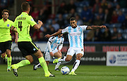 Huddersfield Town striker Nahki Wells shoots during the Sky Bet Championship match between Huddersfield Town and Brighton and Hove Albion at the John Smiths Stadium, Huddersfield, England on 18 August 2015.