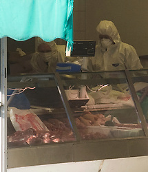 © London News Pictures. 19/11/2011. Police forensics inside Kingsbury Halal Butchers on Kingsbury Road, North West London the scene where four police officers where stabbed early this morning (19/11/2011). A man attacked the police officers with a knife he grabbed from the butchers shop after he had been chased by the police. Photo credit : Ben Cawthra/LNP