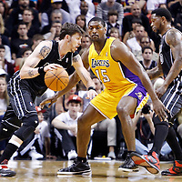 19 January 2012: Los Angeles Lakers small forward Metta World Peace (15) defends on Miami Heat shooting guard Mike Miller (13) during the Miami Heat 98-87 victory over the Los Angeles Lakers at the AmericanAirlines Arena, Miami, Florida, USA.