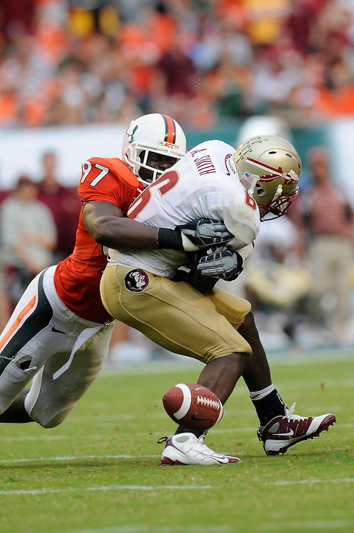 October 4, 2008 - Miami Gardens, FL<br /> <br /> University of Miami defensive lineman Adewale Ojomo hits Florida State University running back Antone Smith causing a fumble during the Seminoles 41-39 victory over the Hurricanes at Dolphin Stadium in Miami Gardens, Florida.<br /> <br /> JC Ridley/CSM