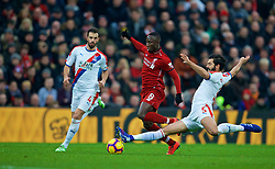 LIVERPOOL, ENGLAND - Saturday, January 19, 2019: Liverpool's Naby Keita (C) is tackled by Crystal Palace's James Tomkins (R) during the FA Premier League match between Liverpool FC and Crystal Palace FC at Anfield. (Pic by David Rawcliffe/Propaganda)