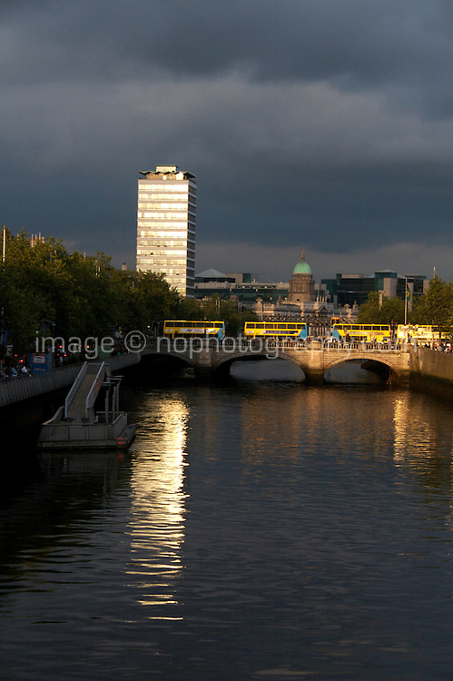 View of the O'Connell bridge over The River Liffey in Dublin city centre Ireland at sunset