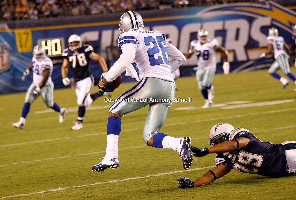 Dallas Cowboys cornerback Cletis Gordon (26) intercepts and returns a fourth quarter pass during a NFL week 2 preseason football game against the San Diego Chargers on Saturday, August 21, 2010 in San Diego, California. The Cowboys won the game 16-14. (©Paul Anthony Spinelli)