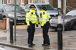 © Licensed to London News Pictures. 02/05/2018. London, UK. Police officers at a cordon in Turner Road next to Queensbury Tube station after a man has died and another injured from gunshot wounds. The man died at the scene almost an hour after officers were called to Cumberland Road just after 9pm on Tuesday. Photo credit: Ray Tang/LNP