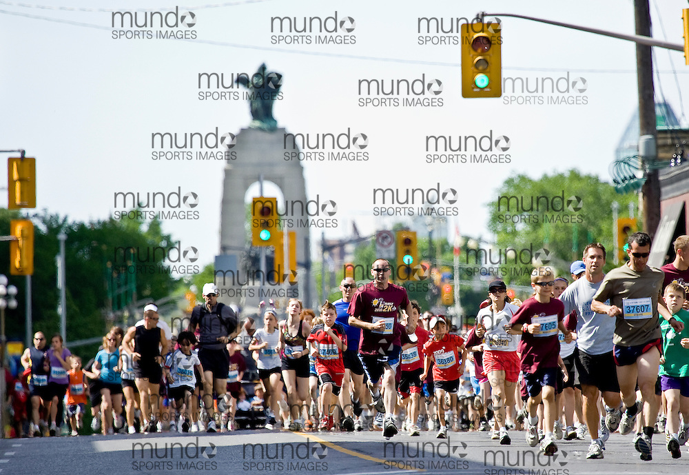 (Ottawa, ON --- May 29, 2010) The lead pack takes out the 2km community race during the Ottawa Race Weekend. Photograph copyright Sean Burges / Mundo Sport Images