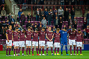 The Hearts players observe a minutes silence in memory of former player Bobby Prentice, who died earlier this week, before the Betfred Scottish Football League Cup quarter final match between Heart of Midlothian FC and Aberdeen FC at Tynecastle Stadium, Edinburgh, Scotland on 25 September 2019.