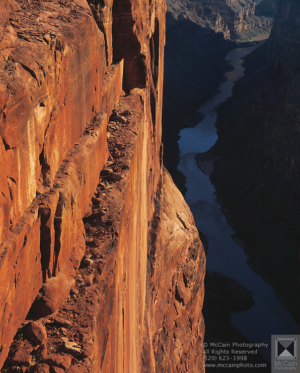 Toroweap Point, sunrise, 3000 feet sheer vertical cliff, Colorado River below, looking into Muave Gorge of Grand Canyon, Grand Canyon National Park, Mohave County, Arizona...Subject photograph(s) are copyright Edward McCain. All rights are reserved except those specifically granted by Edward McCain in writing prior to publication...McCain Photography.211 S 4th Avenue.Tucson, AZ 85701-2103.(520) 623-1998.mobile: (520) 990-0999.fax: (520) 623-1190.http://www.mccainphoto.com.edward@mccainphoto.com..