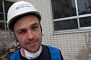 Dave Gutteridge, a comedian from Canada, and a Peace Boat volunteer takes part in the clean-up operations in Ishinomaki, Miyagi Friday May 6th 2011. Around 350 volunteers took part in the relief effort over the Golden Week holiday, including 41 foreigners, clearing mud and removing debris from this coastal town which more almost levelled in the March 11th earthquake and tsunami.