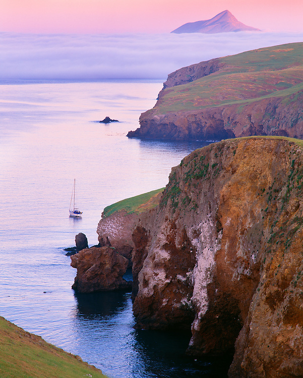 0603-3026B ~ Copyright:  George H. H. Huey ~ Sunset at Little Scorpion Anchorage, Santa Cruz Island, with Anacapa Island and fog bank in distance.  Channel Islands National Park, California.