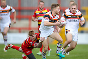Bradford Bulls stand off Joe Keyes (7) is tackles by Dewsbury Rams fullback James Glover (23) during the Kingstone Press Championship match between Dewsbury Rams and Bradford Bulls at the Tetley's Stadium, Dewsbury, United Kingdom on 10 September 2017. Photo by Simon Davies.