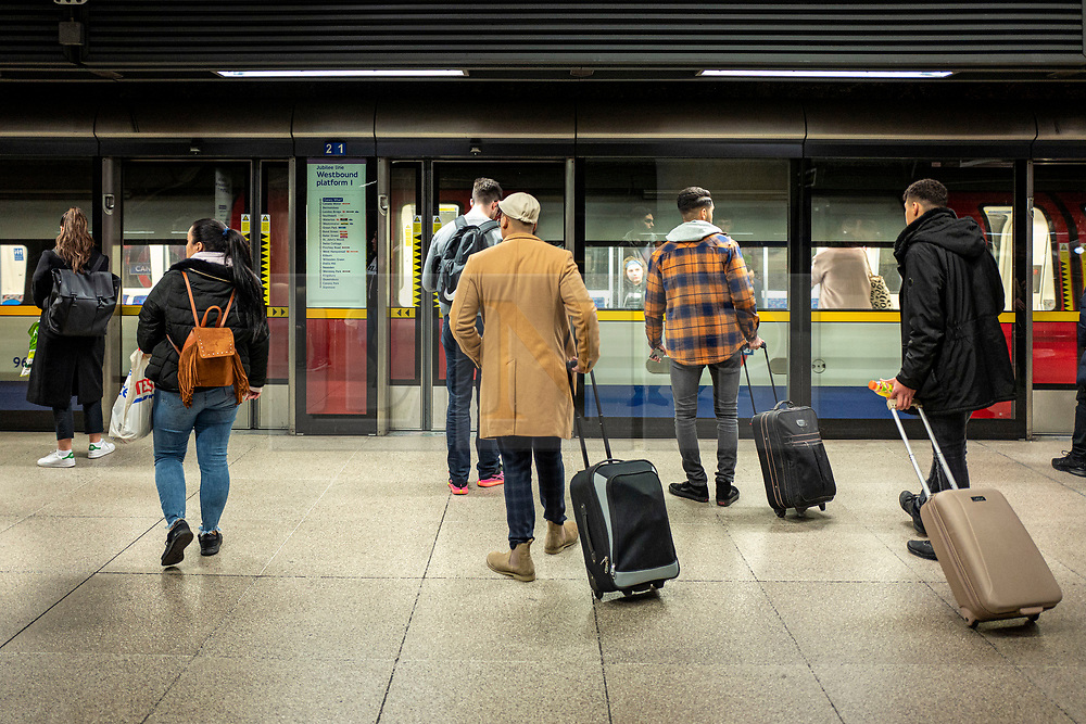 © Licensed to London News Pictures. 20/03/2020. London, UK. People wait on the platform at Canary Wharf for a London Underground train as the Coronavirus outbreak continues to escalate in London. Photo credit: Rob Pinney/LNP