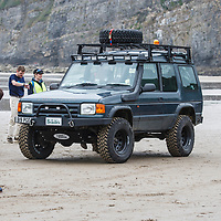 Land Rover Defender (1984-1985) at Pendine Sands, 21 July 2015, for the commemoration of the 90th anniversary of Sir Malcolm Campbells new world landspeed record where he achieved 150miles/hr in his 350hp Sunbeam Blue Bird