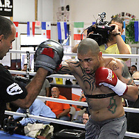 Trainer Pedro Luis Diaz Benitez trains with boxer Miguel Cotto holds media day at K.G. Boxing Gym in Orlando, Florida on Monday, Nov. 21, 2011. Cotto will be defending his World Boxing Association (WBA) super welterweight title against rival Antonio Margarito at Madison Square Garden in New York City, on December 3.  (AP Photo/Alex Menendez)