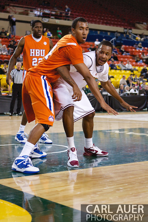 November 25th, 2010:  Anchorage, Alaska - Terry Bembry (24), a forward for Houston Baptist shoots defends the inbound pass in the Huskies 55-73 loss to the Arizona State Sun Devils at the Great Alaska Shootout.