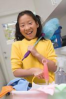 Girl (10-12) doing housework