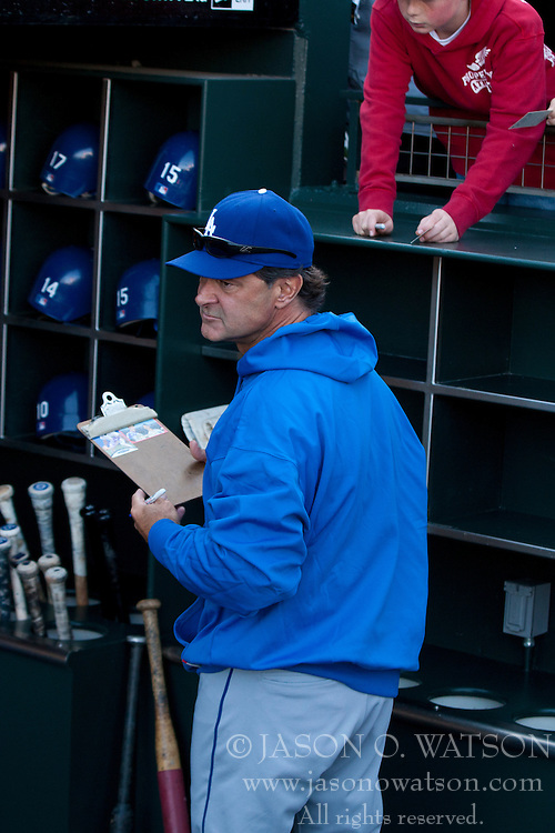 April 11, 2011; San Francisco, CA, USA;  Los Angeles Dodgers manager Don Mattingly (8) signs autographs in the dugout before the game against the San Francisco Giants at AT&T Park.  Los Angeles defeated San Francisco 6-1.