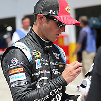 Sprint Cup Series driver Kasey Kahne (5) signs autographs for fans during the 57th Annual NASCAR Coke Zero 400 race first practice session at Daytona International Speedway on Friday, July 3, 2015 in Daytona Beach, Florida.  (AP Photo/Alex Menendez)