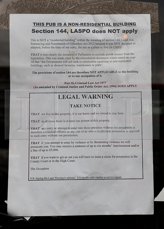 """© Licensed to London News Pictures. 19/06/2015. London, UK. A legal notice stating occupation and """"squatters rights"""" of the Elephant and Castle pub in Southwark, south-east London. A group of activists have occupied the Elephant and Castle pub and are squatting in it to prevent Foxtons Estate Agents from opening an Estate Agent branch. The activists, who are against gentrification want the historic pub site to become a community asset with open use. The Elephant and Castle pub closed earlier this year after its license was revoke and in April, representatives of Foxtons notified planning authorities that they intend to open a branch of the estate agents chain in the pub. Photo credit : Vickie Flores/LNP"""