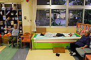 At a senior center in the small city of Nago, Okinawa, elderly Japanese can spend the day in a setting reminiscent of a spa, taking footbaths, enjoying deep-water massage, and lunching with friends. With their caring, community-based nursing and assistance staff, Okinawan nursing homes and senior daycare centers, both public and private, seem wondrous, vibrant and lively places. (Supporting image from the project Hungry Planet: What the World Eats)