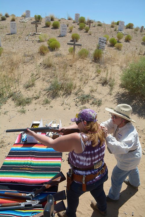 gbs072917m/RIO-WEST -- Annette Garcia of Albuquerque aims a double barrel shotgun as instructor Shirley Godfrey gives pointers during the Rio Grande Renegades Ladies Shoot  at the Albuquerque Shooting Range Park on Saturday, July 29, 2017. A boot hill is part of the setting at the RGR Hayes City Berms. (Greg Sorber/Albuquerque Journal)