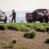 McKinley County Sheriff's officers investigate the scene of a reported pedestrian fatality on Interstate Highway 40 west of Gallup Friday.